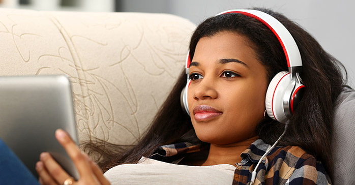 CFA Exam Study Break: Woman watching video on tablet