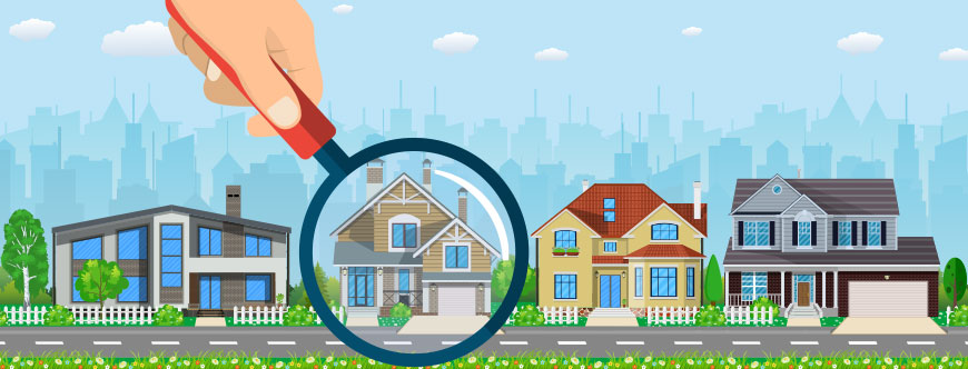Image of a hand holding a magnifying glass over a house