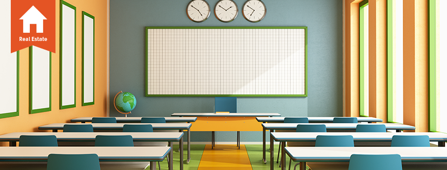 Image of a classroom with desks and a white board