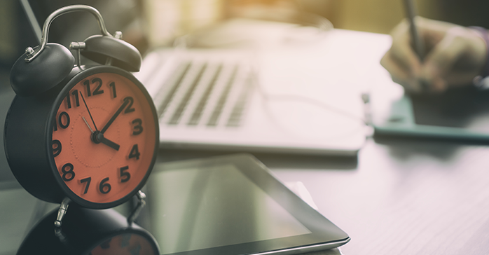 Making the most of 300 hours of CFA Exam study symbolized by clock and study tools