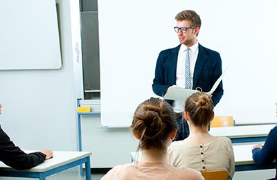 Student listening to free CFA sample class - Kaplan Schweser