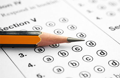 Kaplan Schweser's CFA Live Mock Exam with pencil and paper