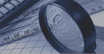 Magnifying glass examining how to become a CFA charterholder