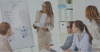 Female asset manager leading a meeting at work - Kaplan Schweser