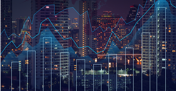 city skyline with charts and graphs signifying financial work