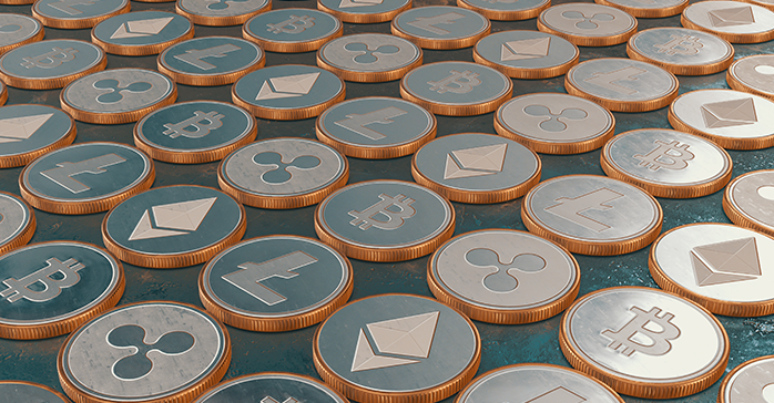 Coins representing cryptocurrency, one of the topics that will be tested on the CFA Exam in 2019