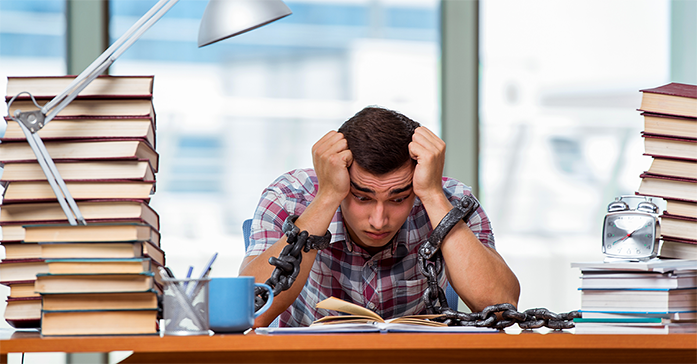 Man overwhelmed while studying the CFA Exam - Kaplan Schweser