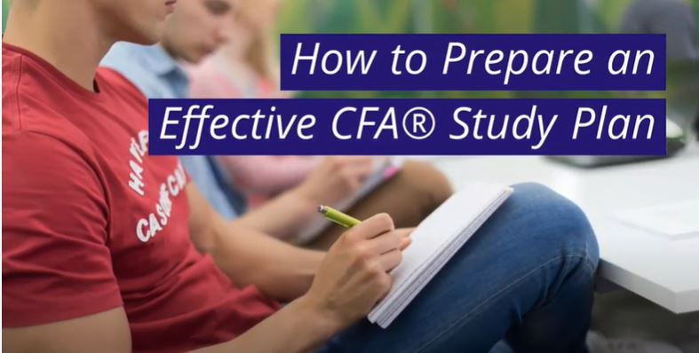 Students in a library studying for the CFA Exam